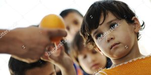 Food to hungry children in refugee camp program
